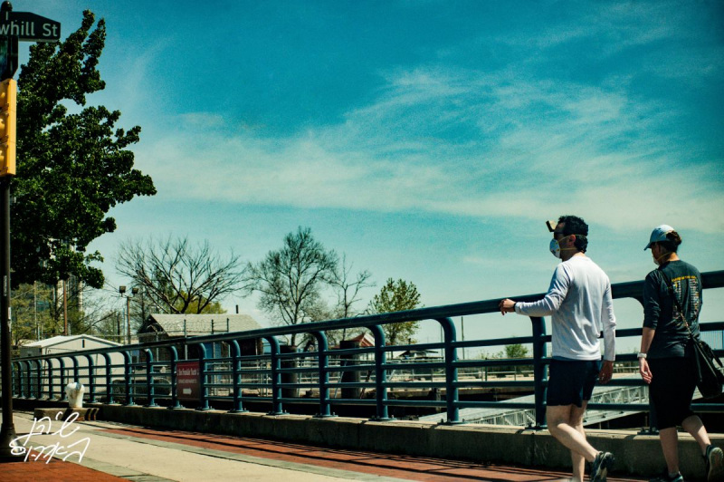 Strolling-Down-Columbus-Covid-Masks-People-Waterfront-Sky-Perspective